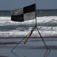 Black & White quartered flag to signify a zone, or the boundary of a zone, designated for use of surfboards and other water craft.